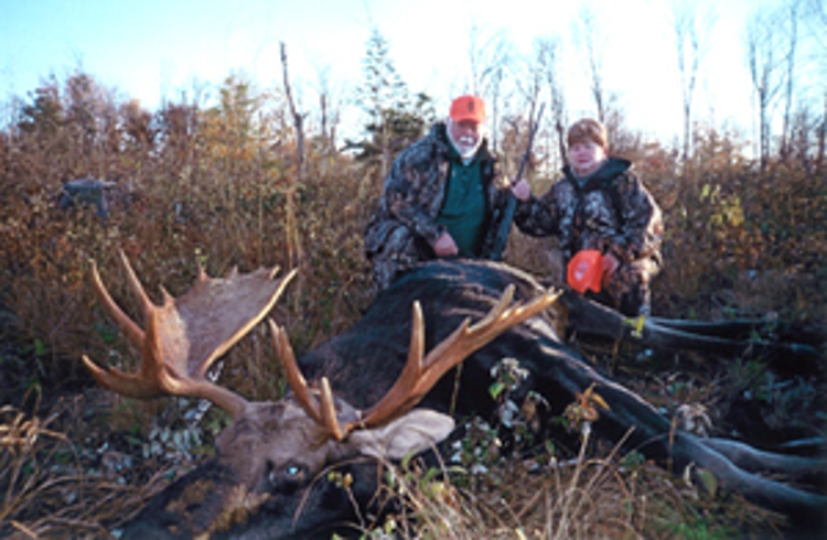 Hunters with trophy moose