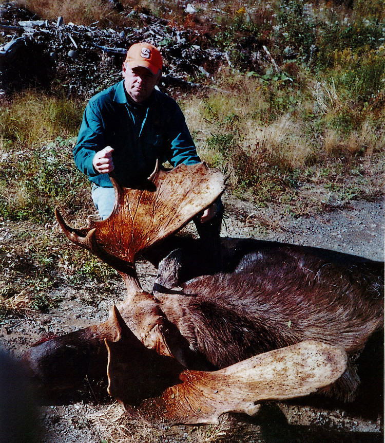 Hunter with trophy moose